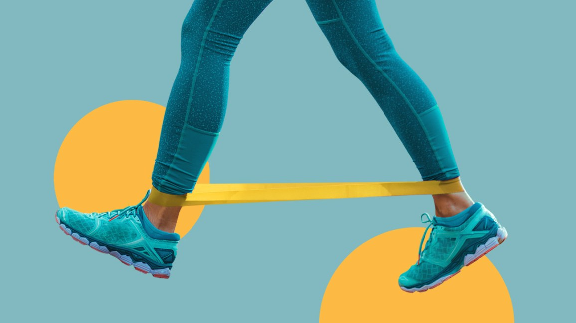 a person taking a wide, strong step with a resistance band looped around their ankles