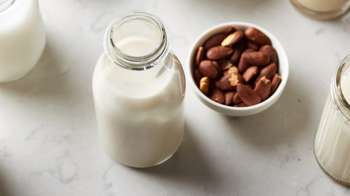 Almond milk and a bowl of almonds
