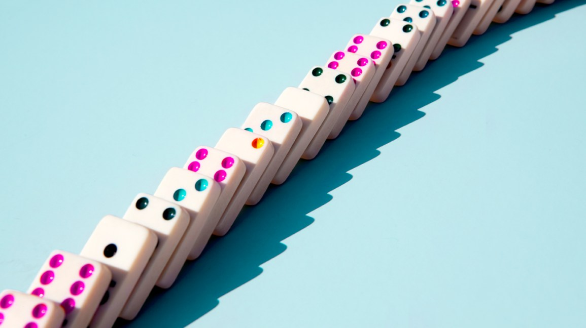 dominoes with colorful pips (dots) falling, symbolizing multiple consecutive orgasms