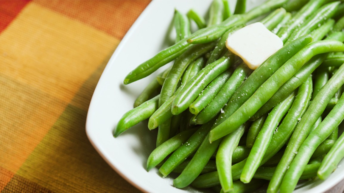 Green beans with a piece of butter