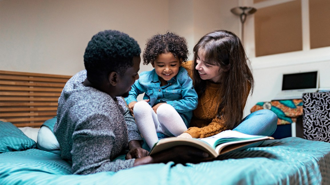 parents read book with toddler