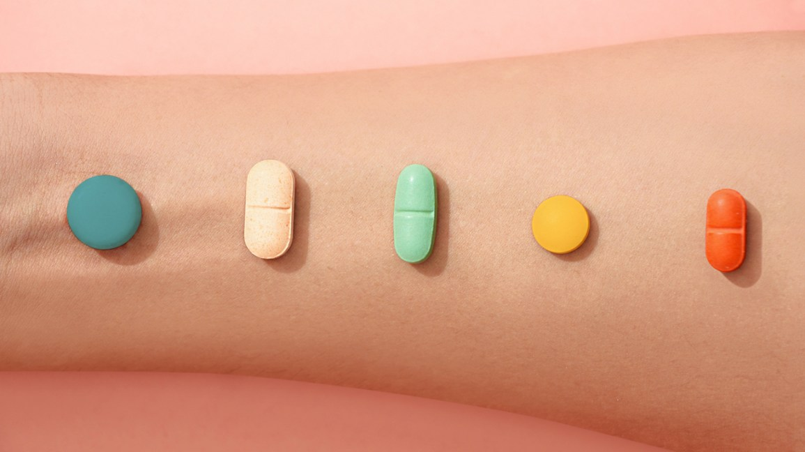 Vitamins arranged on forearm