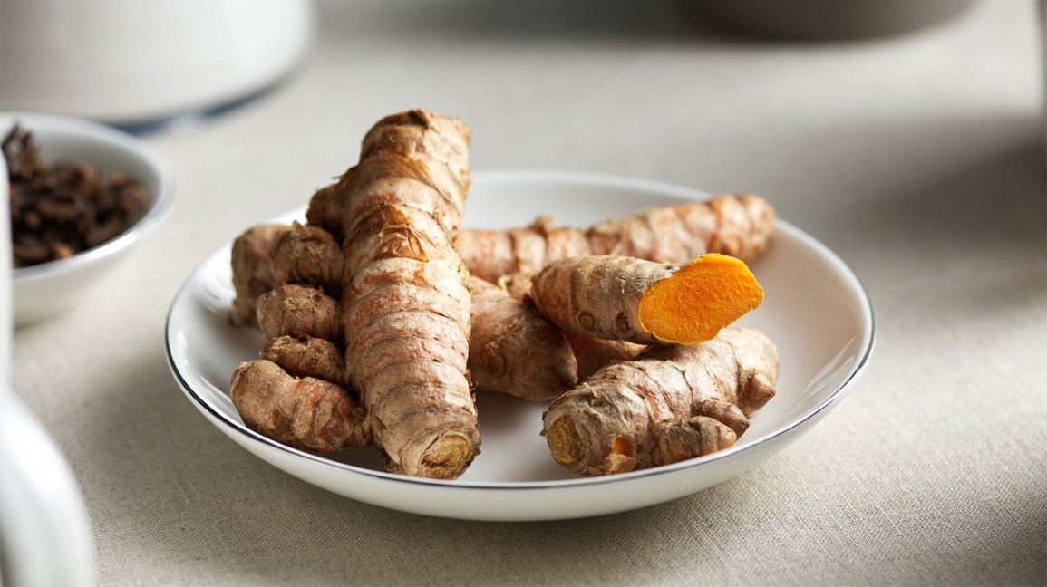 raw turmeric root on a plate