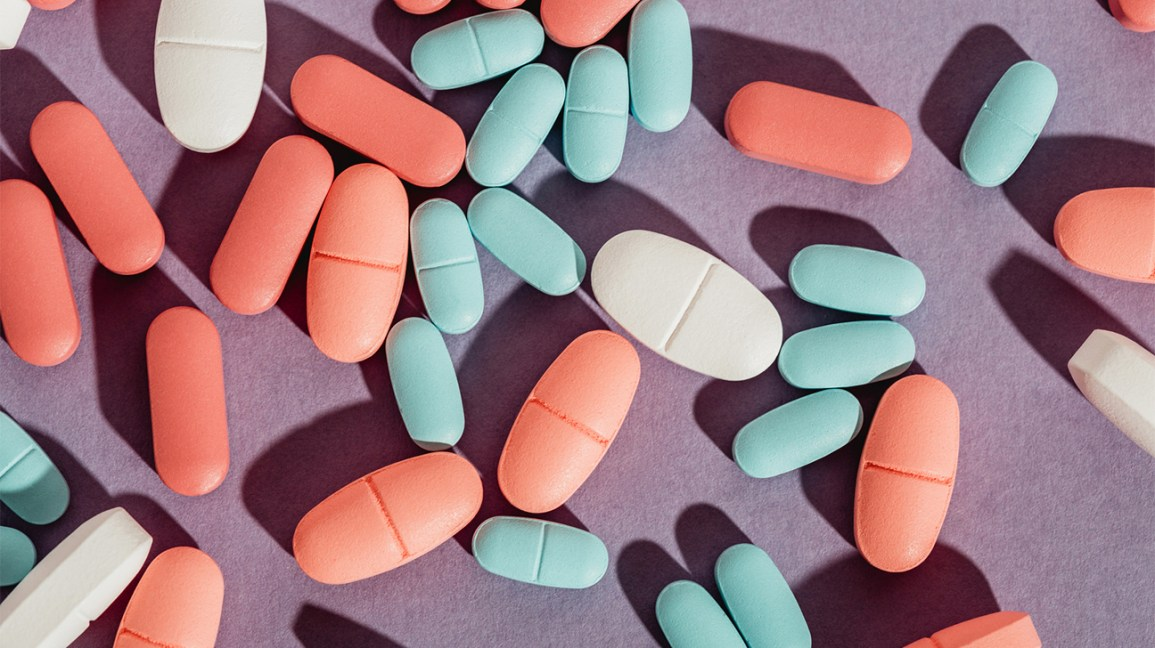an assortment of pills on a purple backdrop
