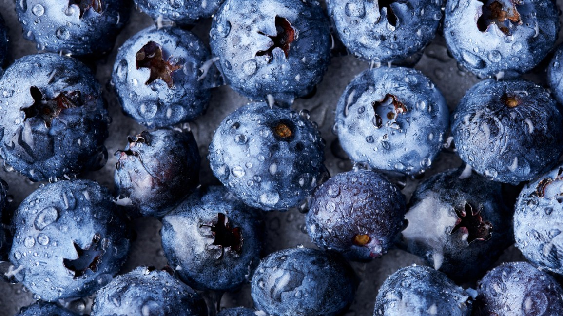 wet blueberries closeup 1296x728 header