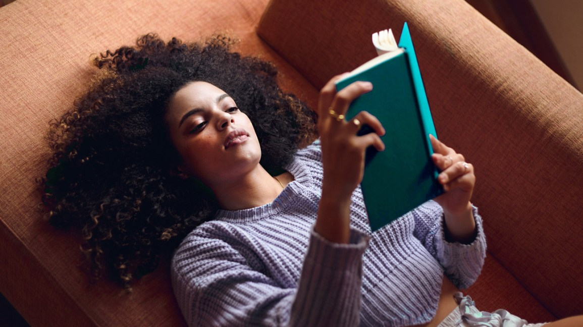 Woman reading book and relaxing