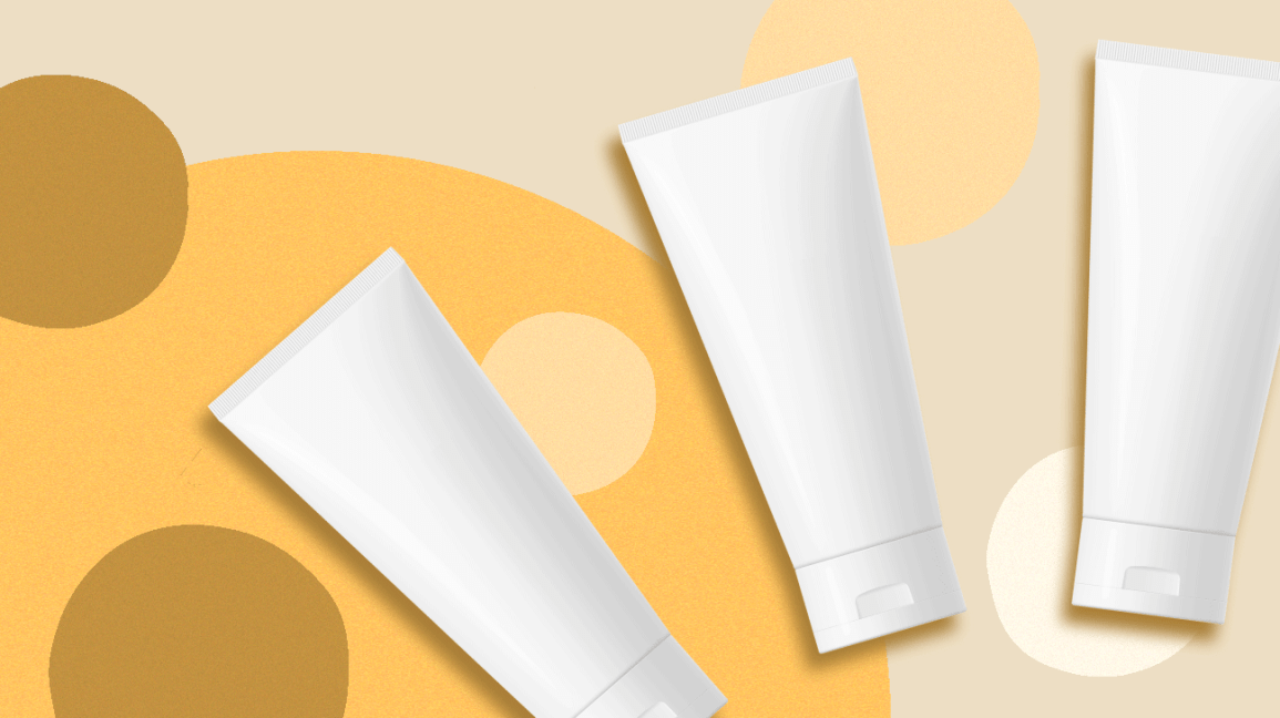 Three unmarked tubes of sunscreen on a polka dot background.