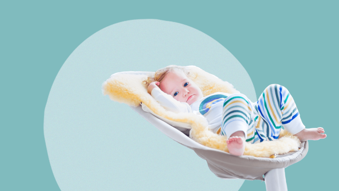 baby in a swing on a blue circular background