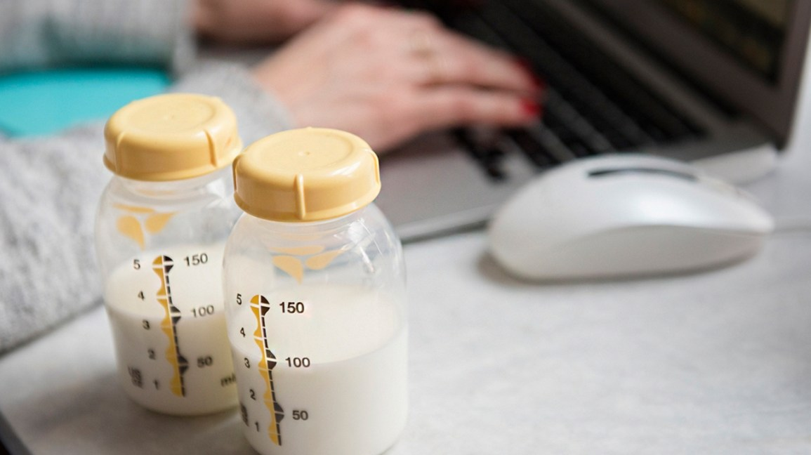 Breast milk in bottles on desk
