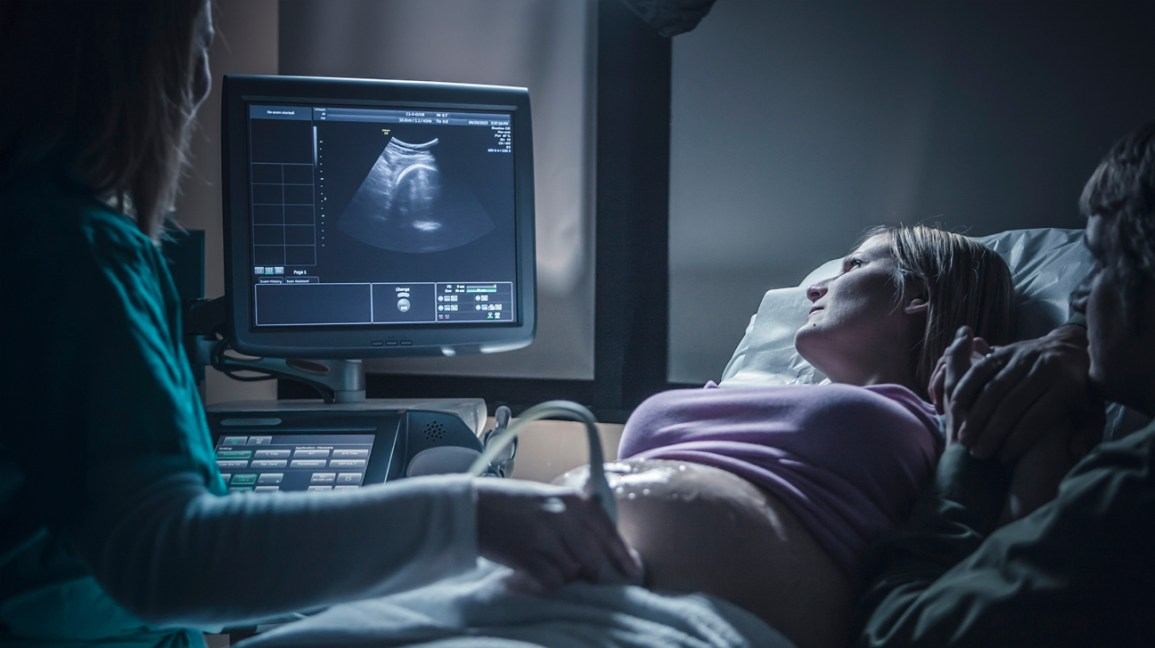 Pregnant person having ultrasound