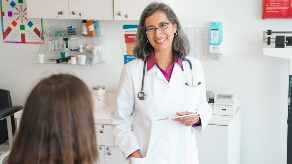 A female doctor smiling at her patient