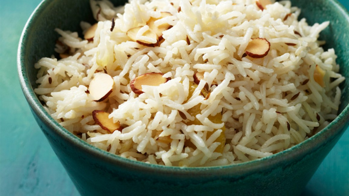 cooked basmati rice in a bowl with almond slivers