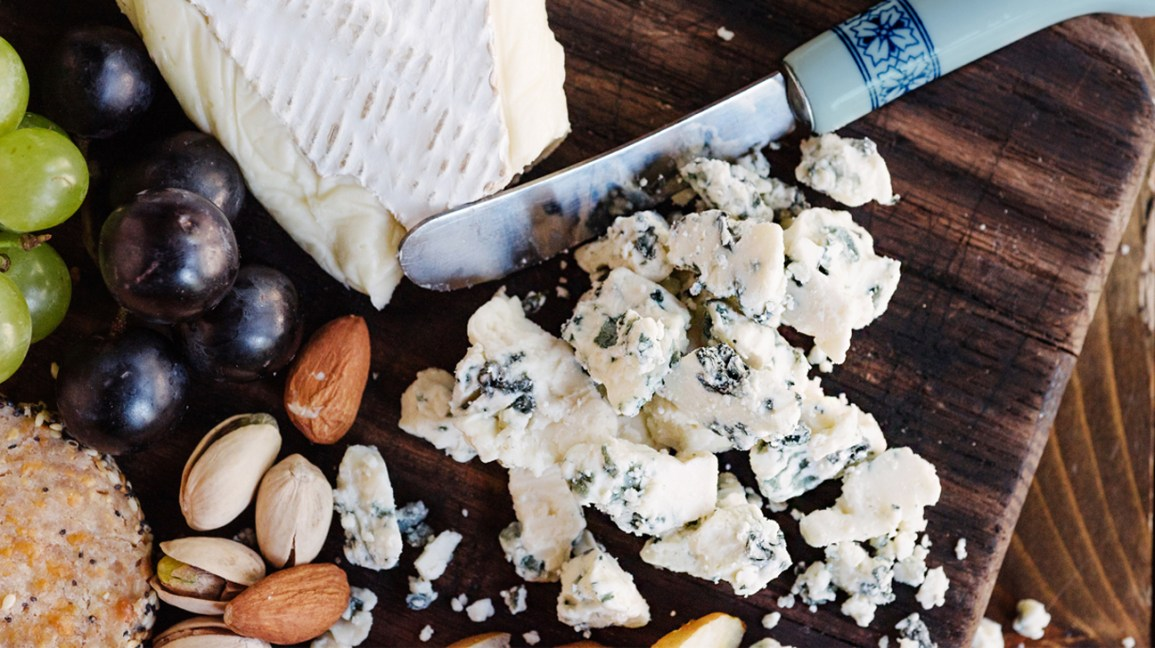 crumbled blue cheese on a serving board