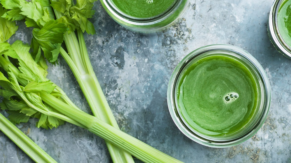 celery juice in glasses with celery stalks