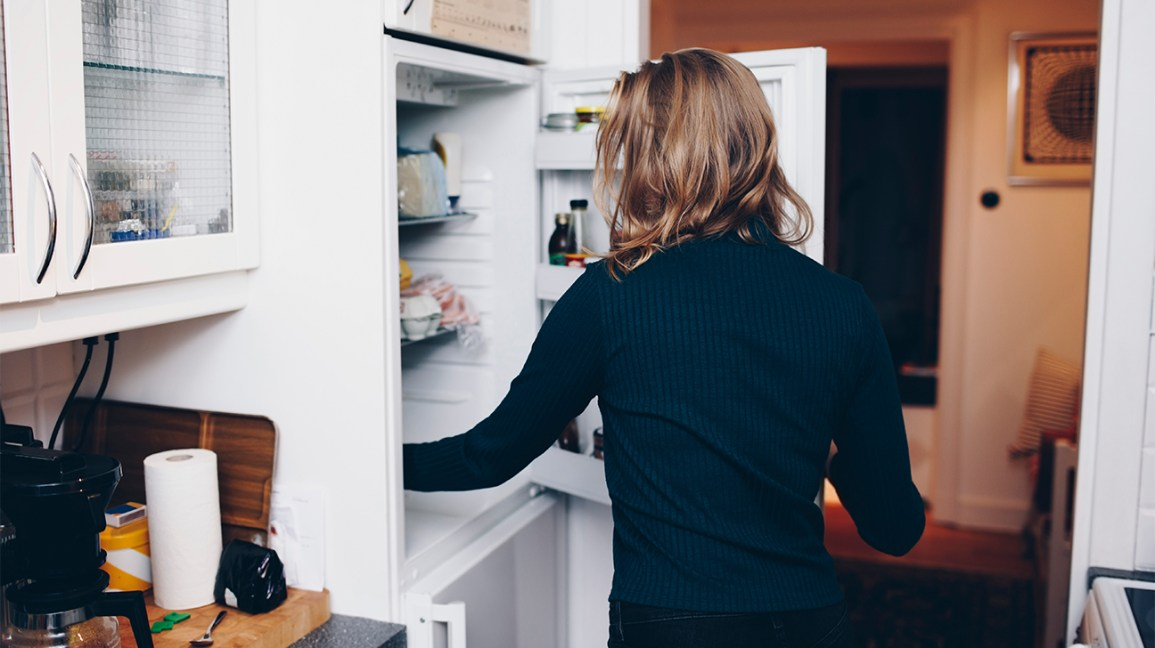 Person reaching for something in the refrigerator