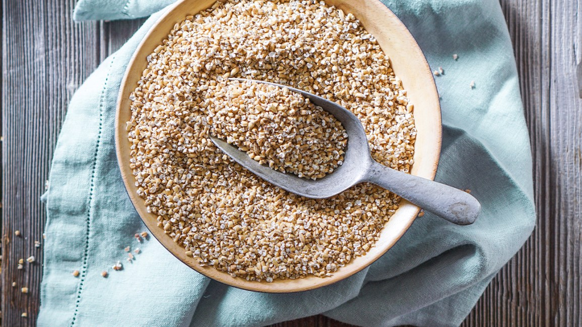 raw steel cut oats in a bowl with scoop