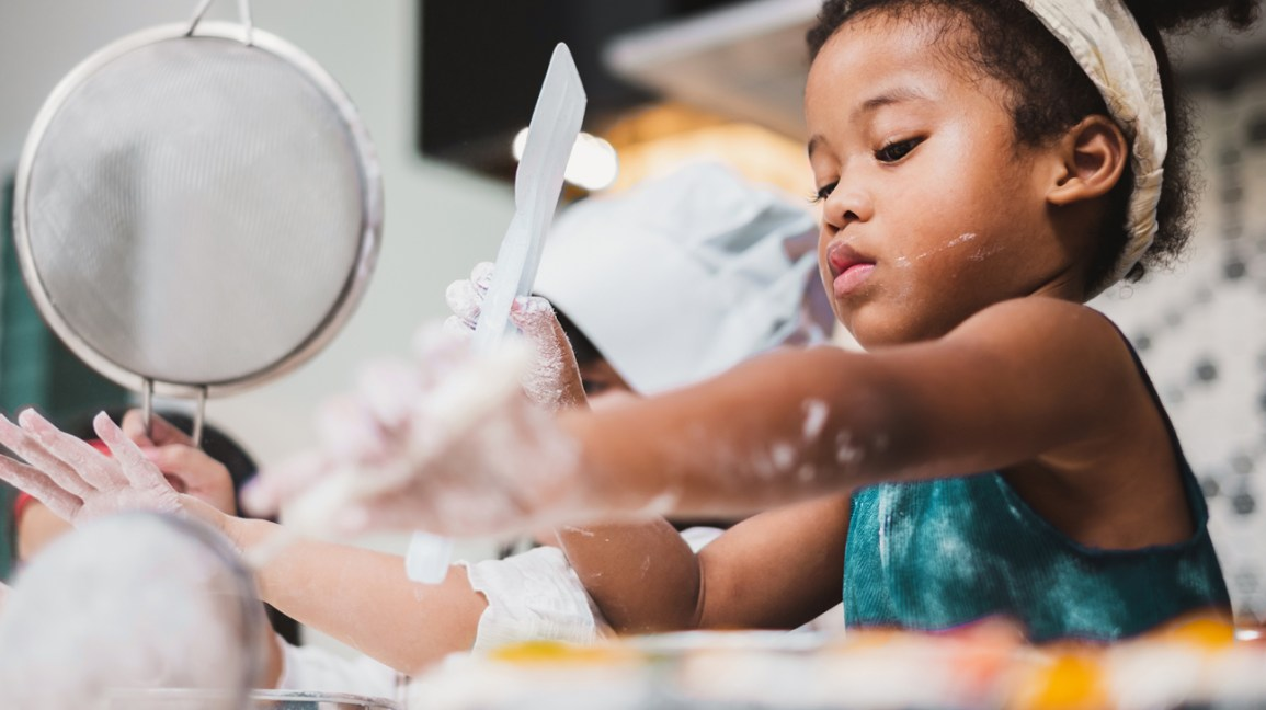young girl messy during sensory play