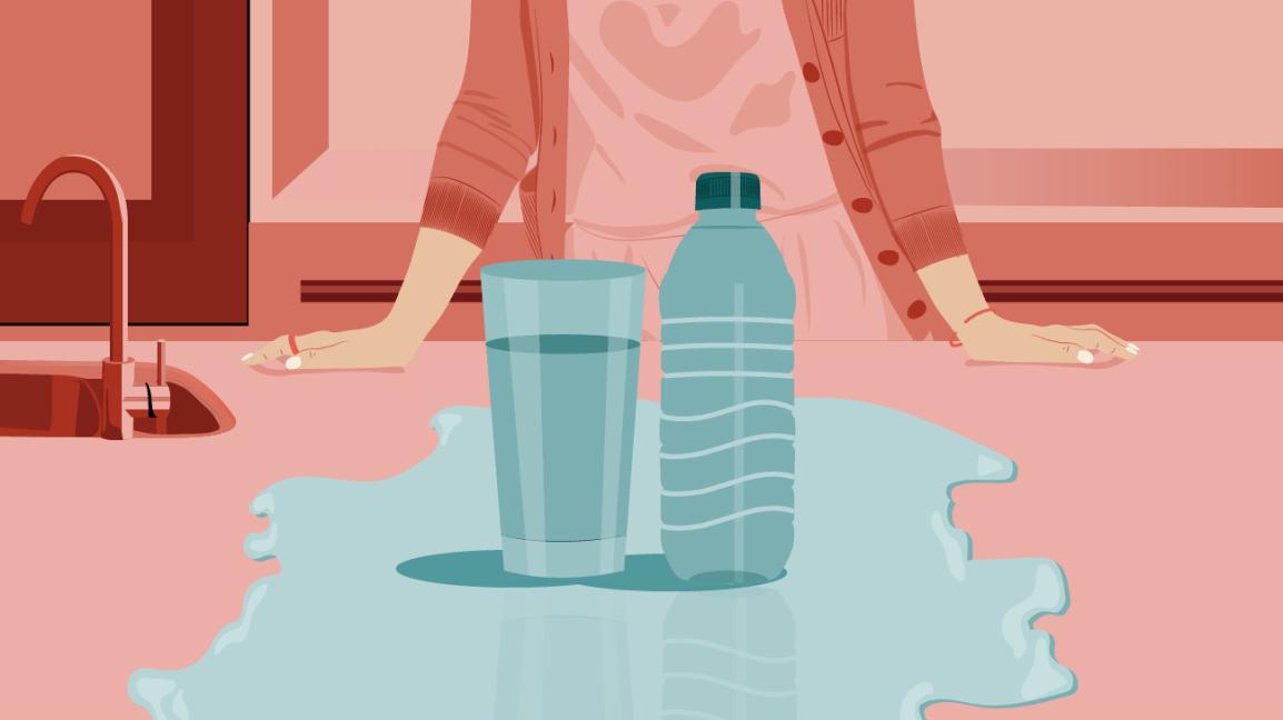 a glass of tap water beside a plastic water bottle
