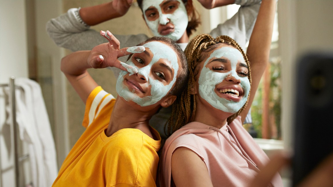 three friends doing face masks