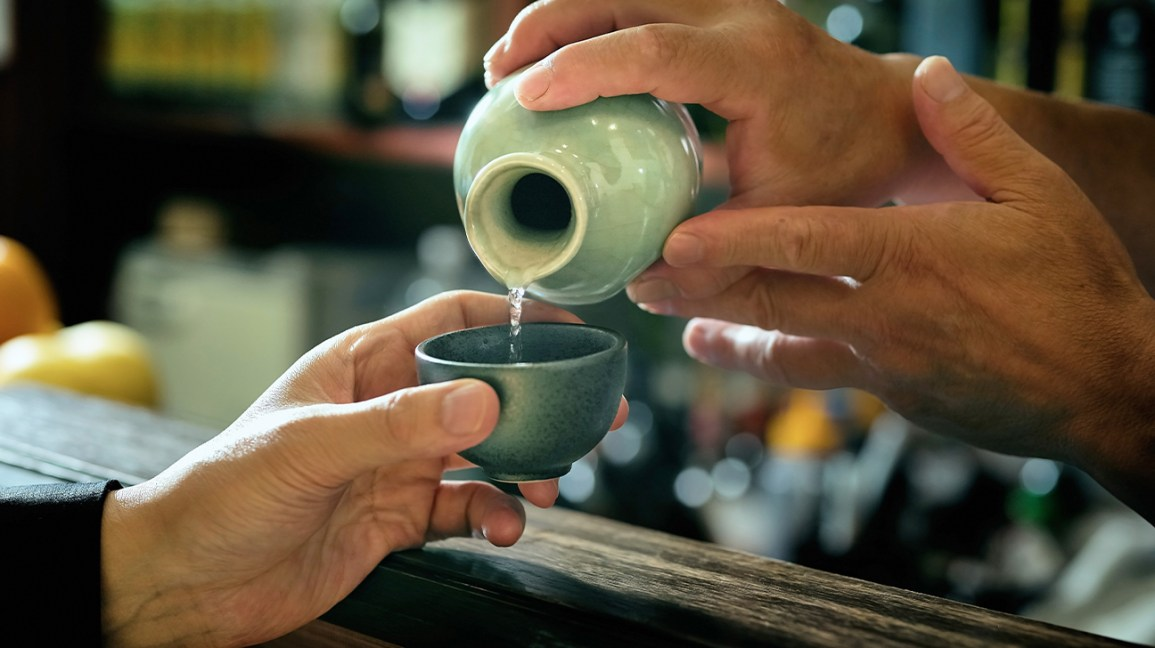 Sake being poured