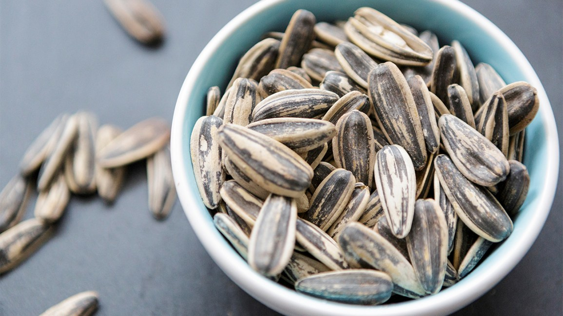whole sunflower seeds (in their shells) in a bowl