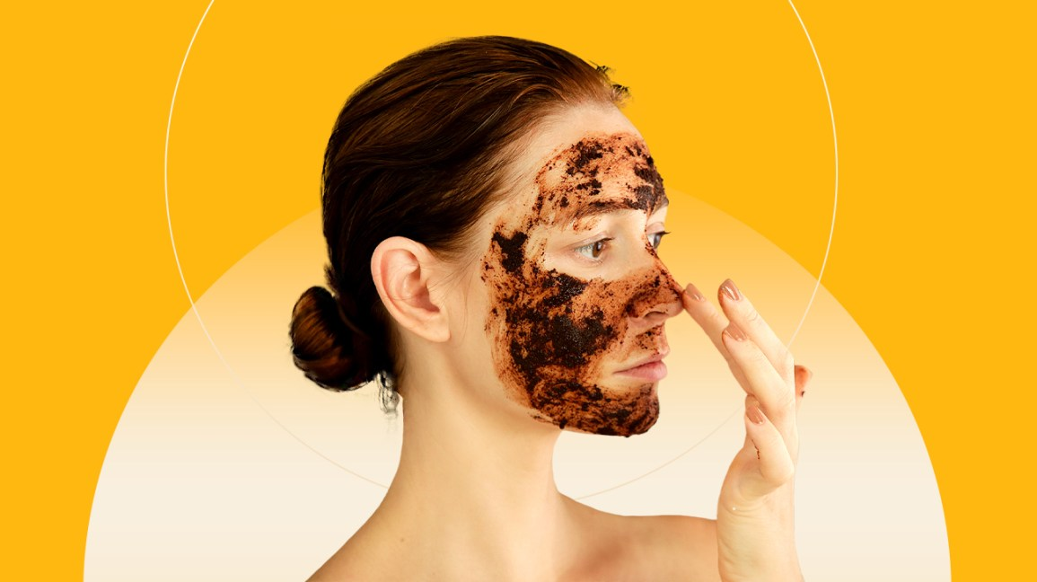 Woman exfoliating her face