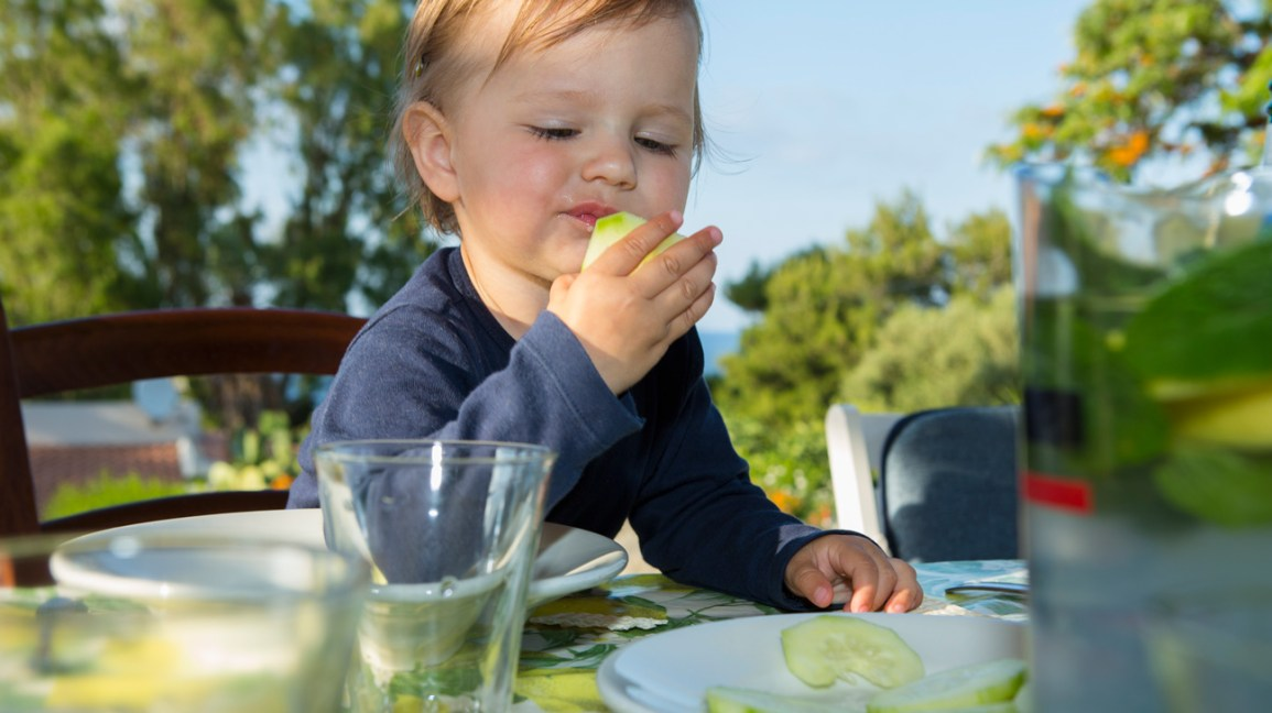 Baby with cucumber