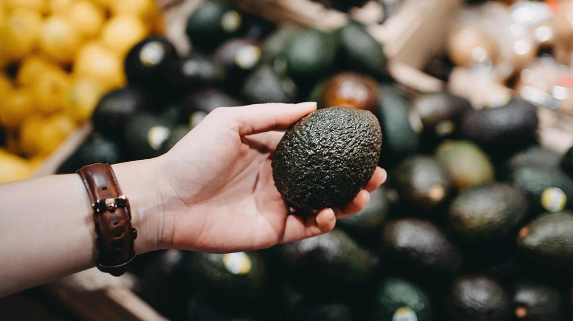feeling an avocado in the store