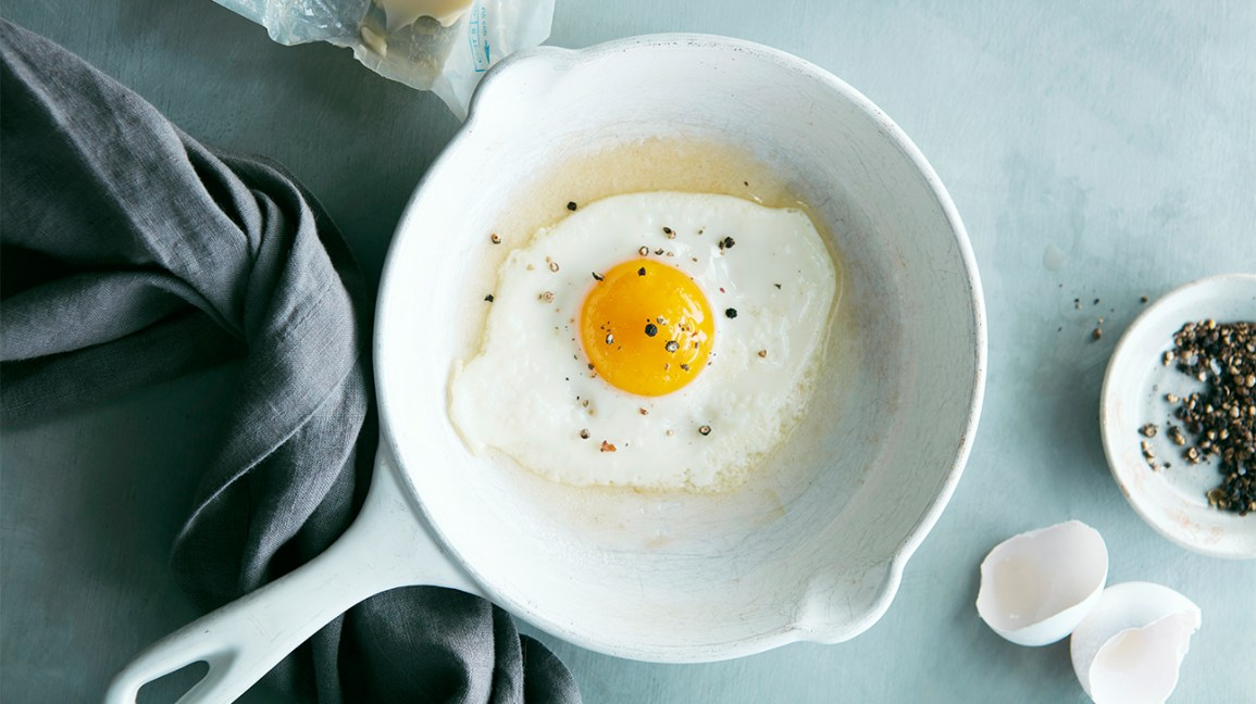 fried egg with cracked pepper in a skillet