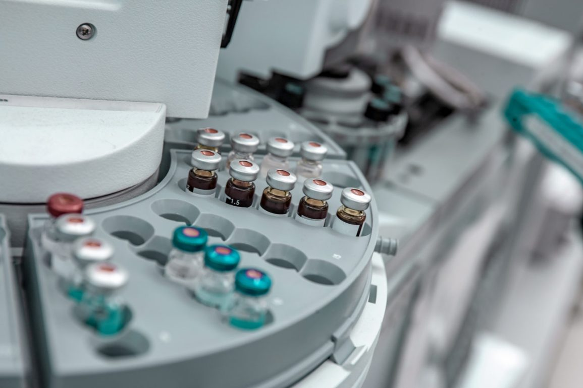 Vials in a centrifuge in research in biologics for severe asthma