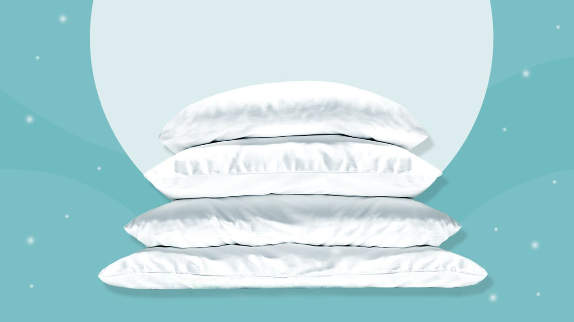 An image of 4 pillows stacked one on top of the other against an aqua-blue background.
