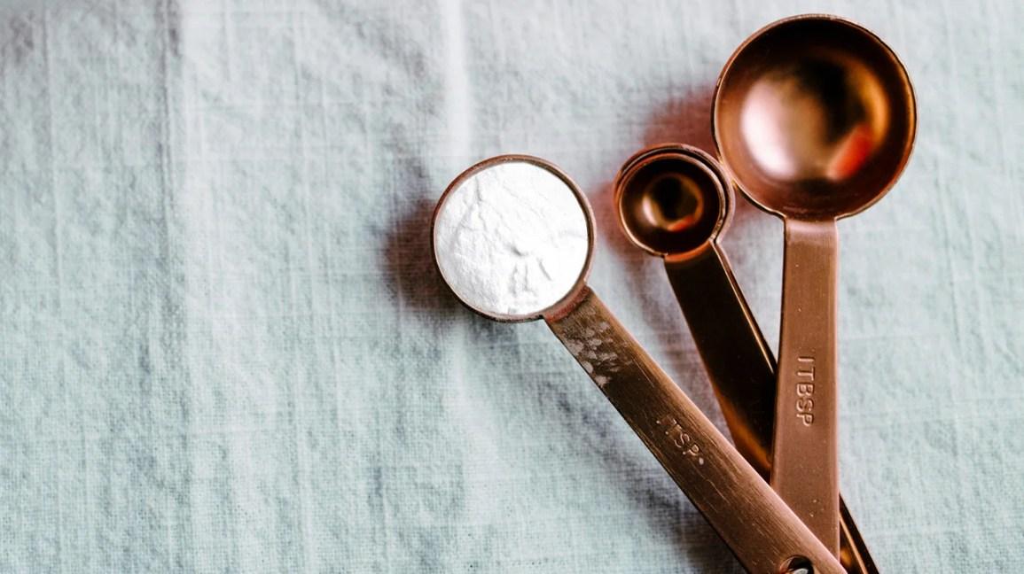 baking soda in a measuring spoon