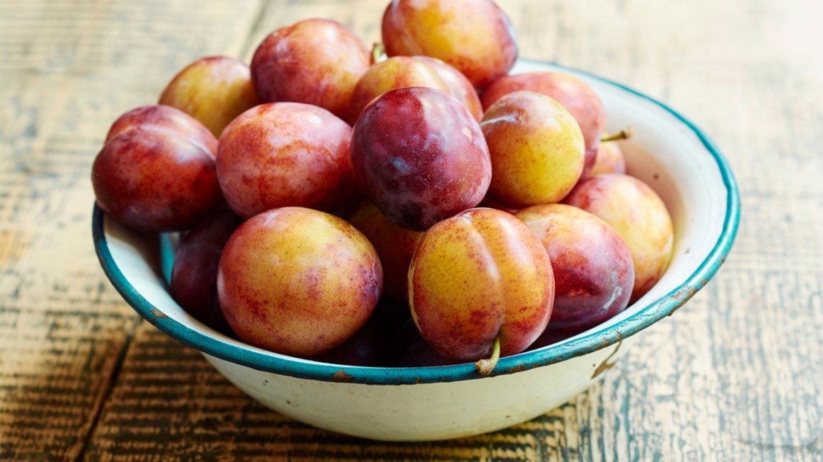 a bowl of fresh plums