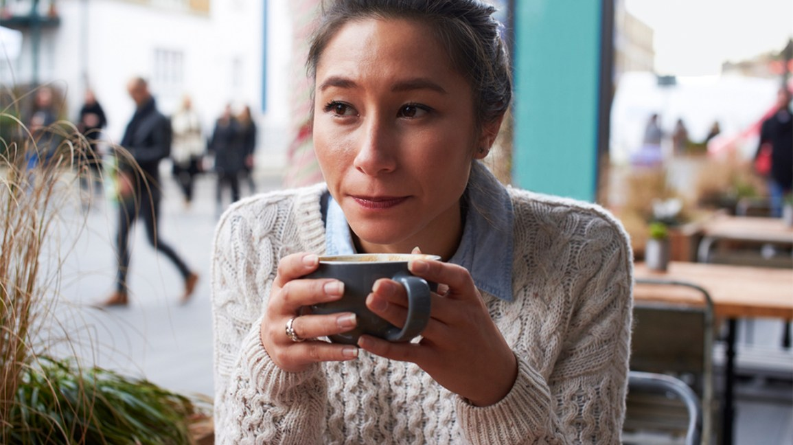 a woman with a mug of hot tea or coffee