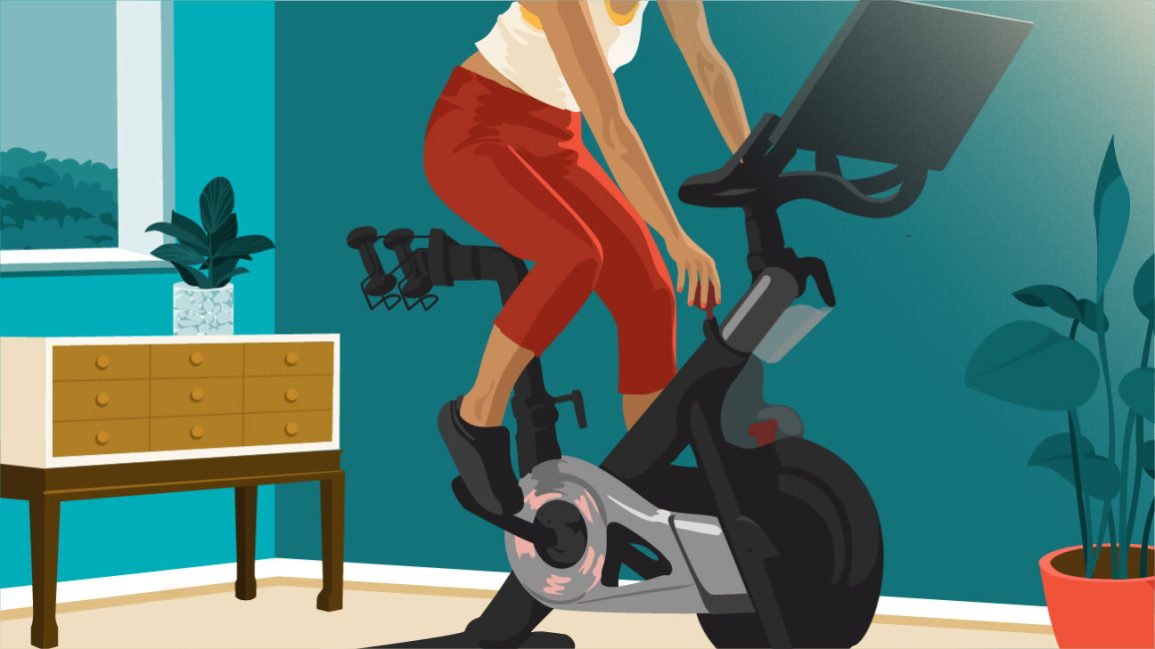 person working out on stationary bike