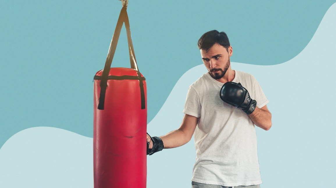 man practicing with punching bag