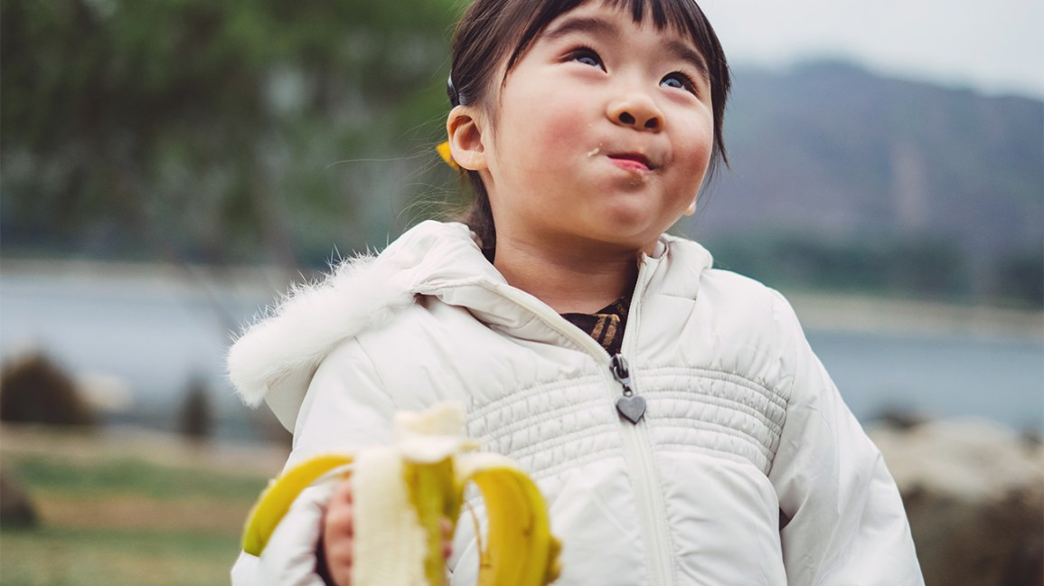 kid eating a banana