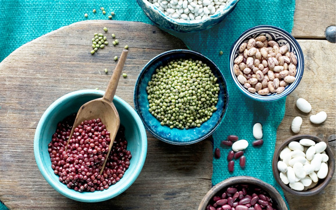 Various types of beans in different bowls