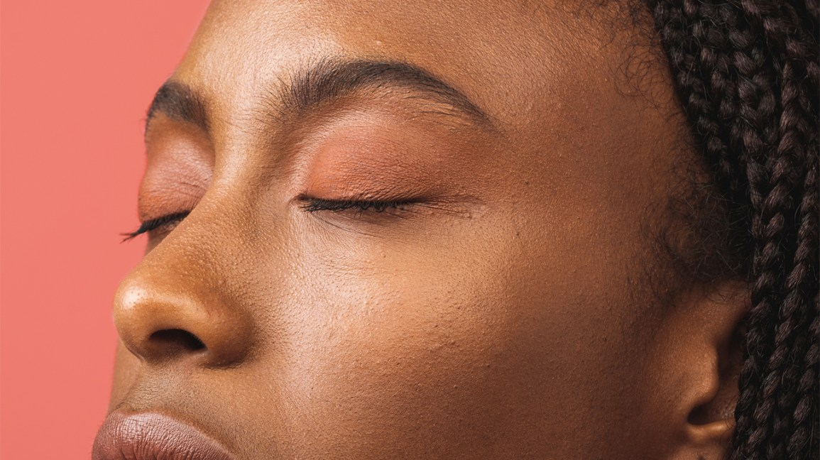 woman practicing meditation with eyes closed