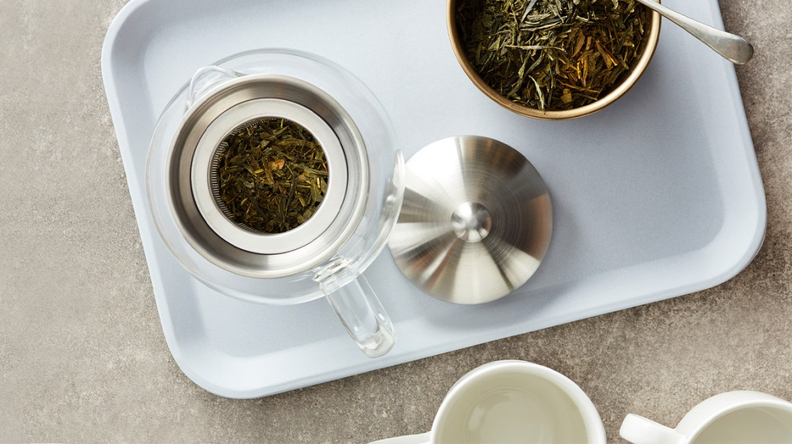loose leaf tea on tray and in teapot