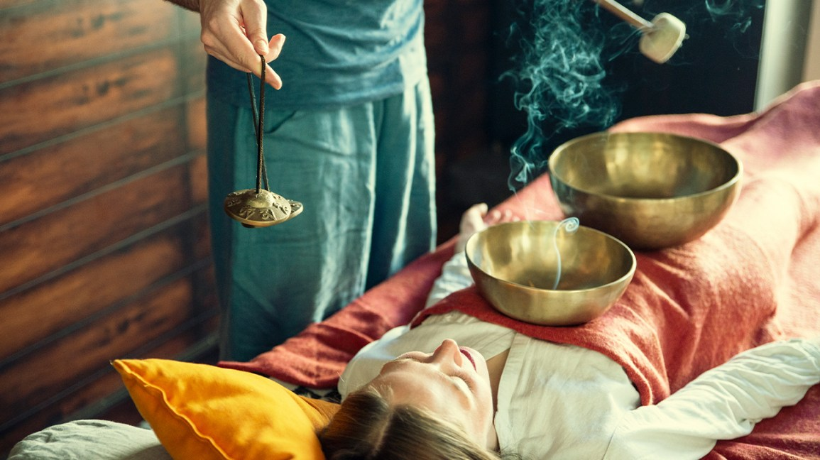 dangers of singing bowls, woman receiving singing bowl therapy