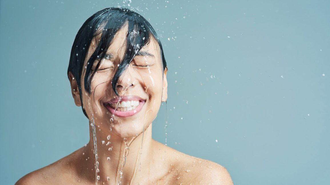 person recently doused in water, smiling and dripping wet