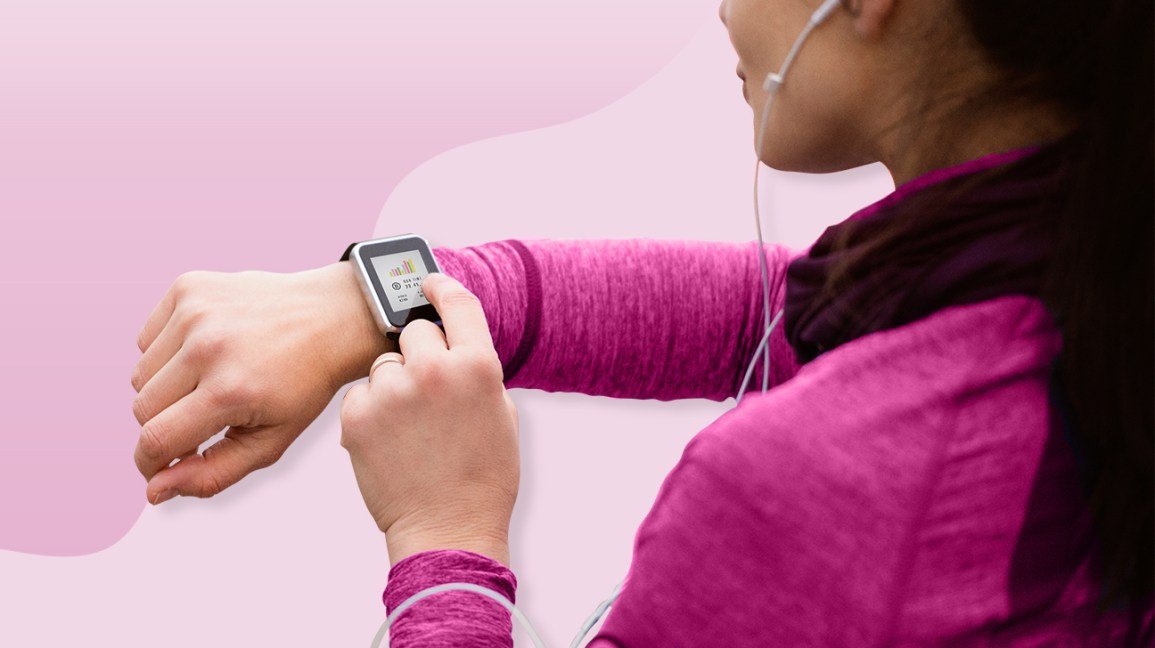 Woman looking at her heart rate monitor watch