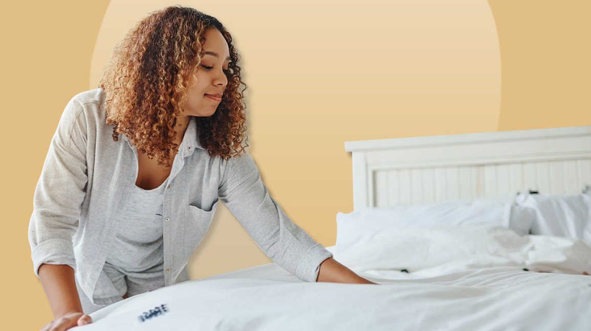 Woman smoothing mattress