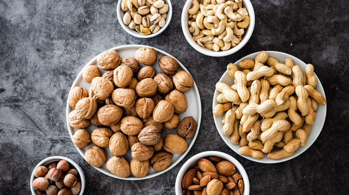Different types of nuts in bowls