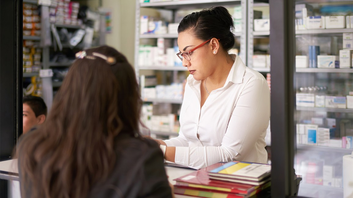 pharmacist reading plan b instructions to a patient