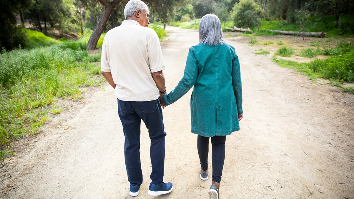 Elderly couple going for a walk