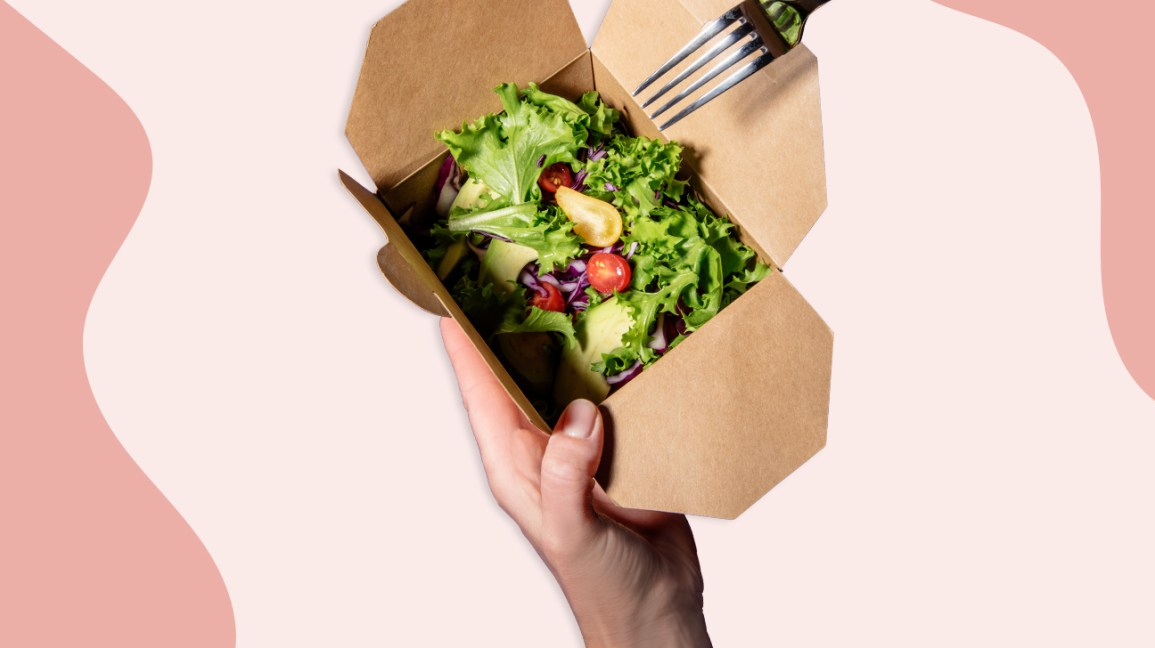 eating fresh salad from a box