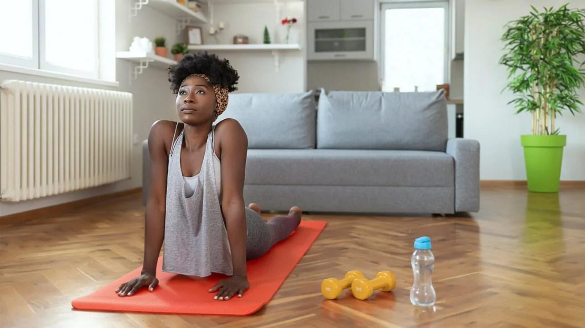 Female Living Room Yoga 1296x728 header