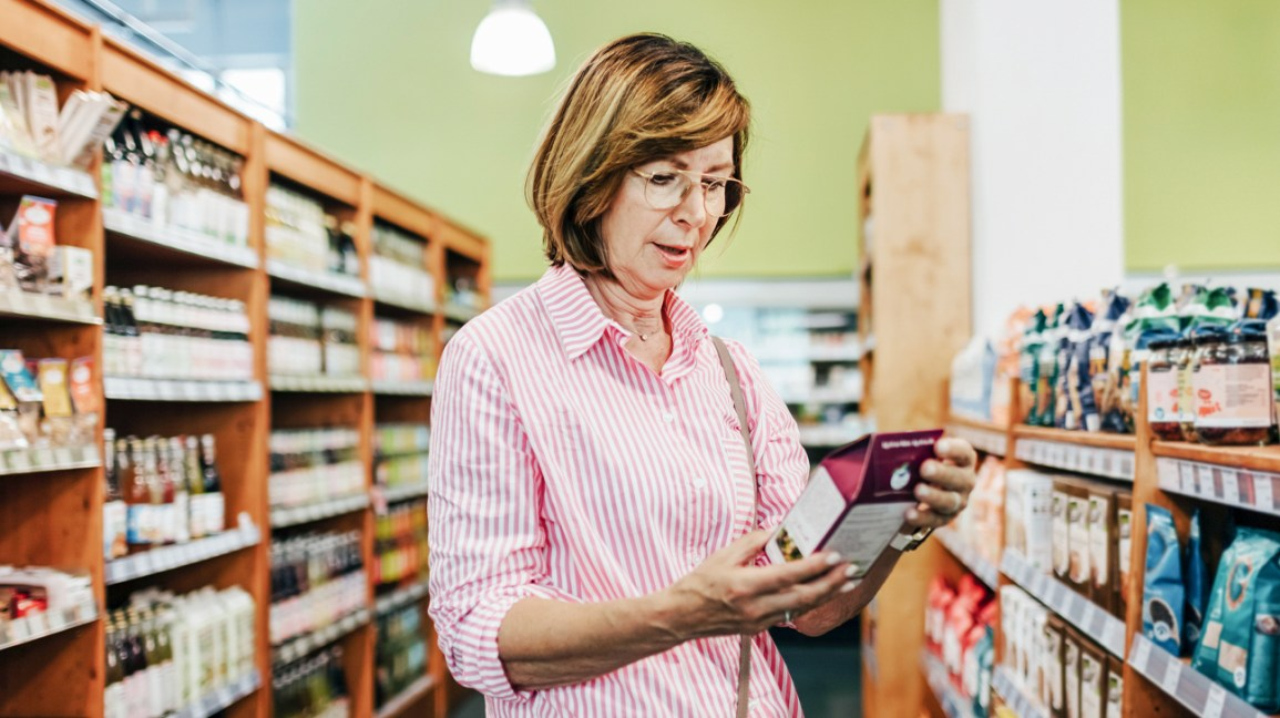 Woman reading nutrition facts